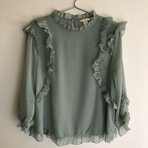 H&M. Sage colored ruffle blouse.